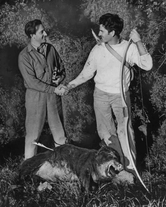 Basil Rathbone & Howard Hill over prey.