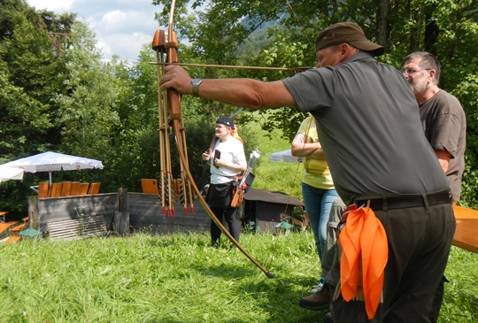 True Traditional Archery in Waidring, Tirol, Austria. 100 competing archers wearing the
