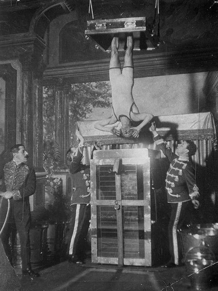 Houdini performing the Chinese Water Torture Cell